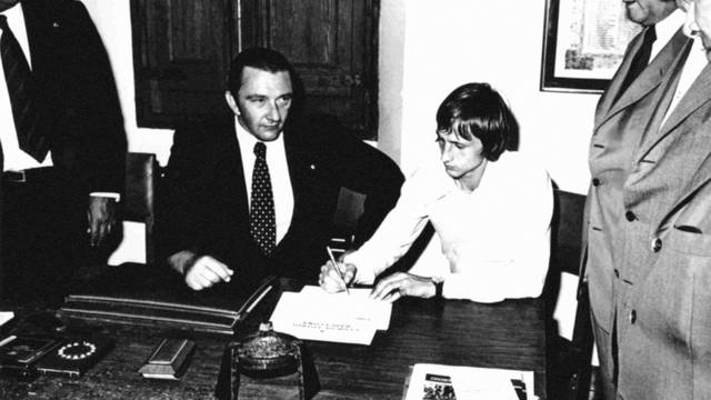 Photo of  Johan Cruyff as he signs his contract before Montal