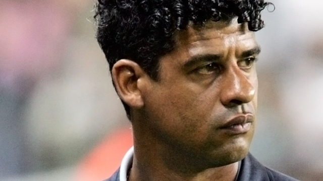 Photo of an elegantly dressed Frank Rijkaard