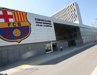 view of the Barça crest on the wall of the ciutat esportiva building