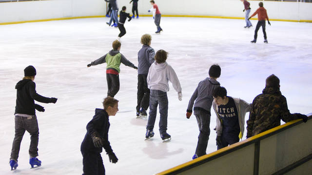 Image of children skating on the ice rink