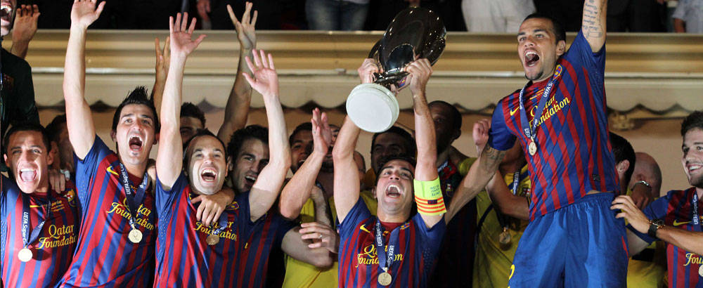 The Barça first team leaping for joy after winning another title