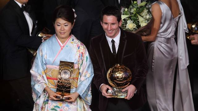 Homare Sawa and Lionel Messi