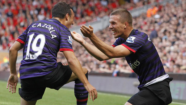 Cazorla and Podolski celebrating a goal/ PHOTO: Skysports