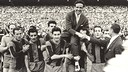 Picture of Helenio Herrera being carried by his players