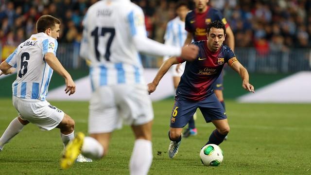 Xavi vs. Málaga / PHOTO: MIGUEL RUIZ - FCB