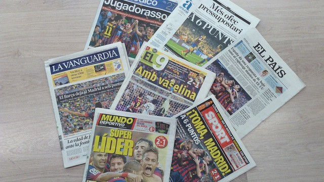 Front pages covering the Clásico 2013/14