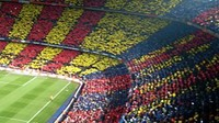 The Camp Nou full of fans and with Catalan and Club mosaics. This is the winning picture