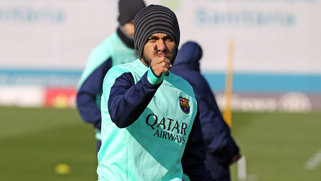 Dani Alves pointing with a serious look on his face while training at the Ciutat Esportiva