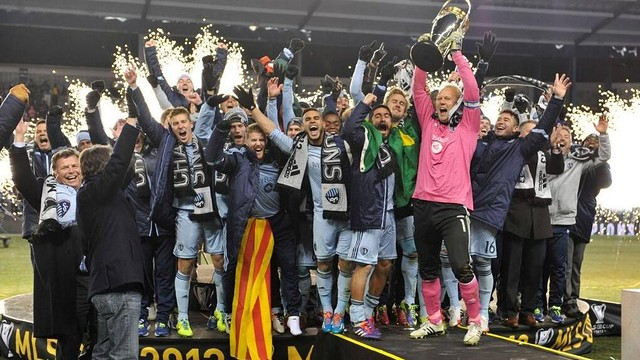 Rosell celebrates winning the title with his team-mates