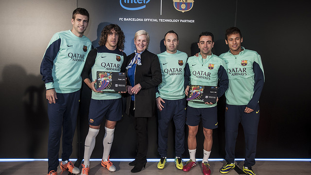 Gerard Piqué, Puyol, Iniesta, Xavi and Neymar alongside Intel's head of marketing,Deborah Conrad