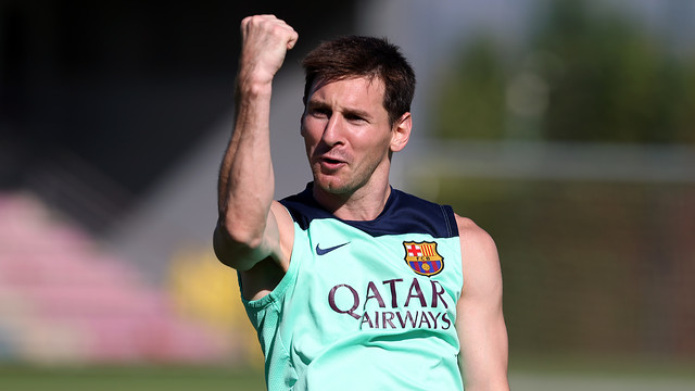 Messi, with his fist raised in a training session in August