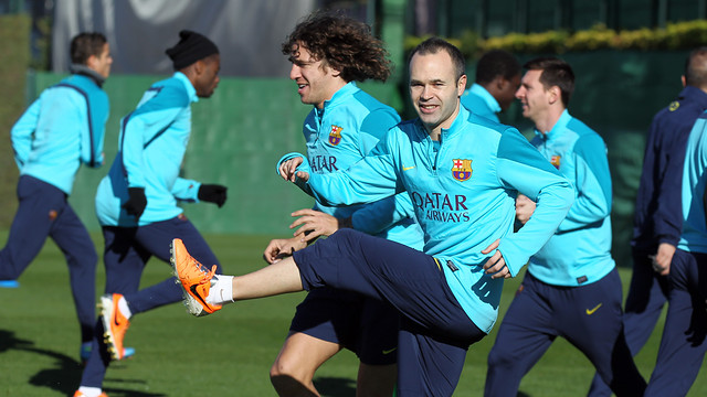 Iniesta and Puyol in a training session. PHOTO: MIGUEL RUIZ-FCB.