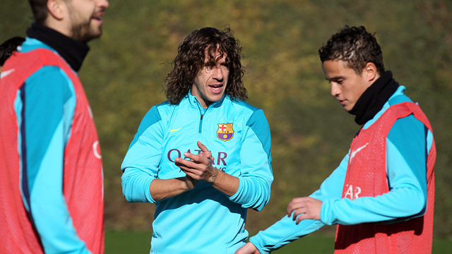 Puyol and Afellay in training