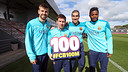 Piqué, Messi, Pinto and Song with the 100 million banner / PHOTO: MIGUEL RUIZ-FCB