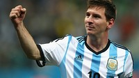 Messi, with his fist raised