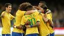 Os jogadores brasileiros celebram um dos gols de Diego Tardelli em Pequim