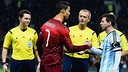 Cristiano Ronaldo and Leo Messi, who both played 45 minutes, shaking hands before the game / PHOTO: FIFA.COM