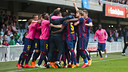 Munir El Haddadi is mobbed by his teammates after his late score sinks Ponferradina at the Miniestadi on Saturday. / VÍCTOR SALGADO - FCB