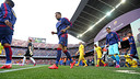 The players emerge from the dressing rooms prior to the start of Tuesday's match at Camp Nou. / MIGUEL RUIZ-FCB