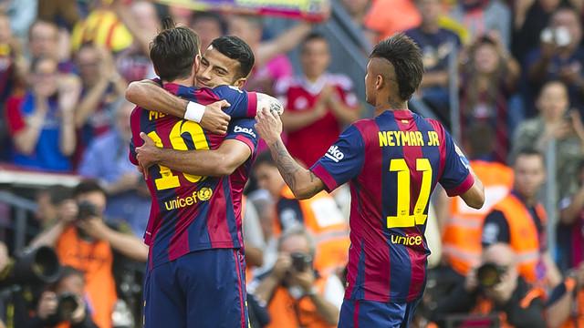 Messi, Rafinha, and Neymar Jr. celebrate Barça's first goal against Deportivo on Saturday at Camp Nou. / VÍCTOR PARGA-FCB