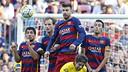 Suárez, Rakitic, Piqué i Sergio salten formant la tanca / MIGUEL RUIZ - FCB