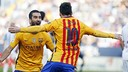 Arda Turan and Leo Messi celebrating against Málaga / MIGUEL RUIZ-FCB