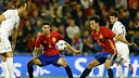 Marc Bartra (left) and Sergio Busquets, in a game for Spain earlier this year. / FCB ARCHIVE